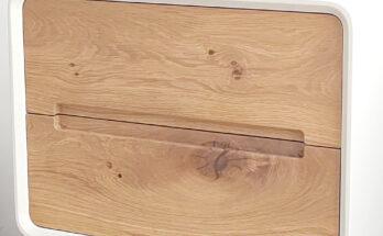 fronturile de sertare din lemn masiv de stejar, cu colturi rotunjite si manere frezate in cant